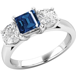 A stunning sapphire & diamond ring with shoulder stones in 18ct white gold