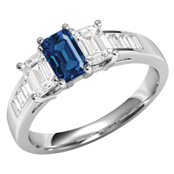 A breathtaking Emerald Cut Sapphire and Diamond three stone ring with shoulders in 18ct white gold