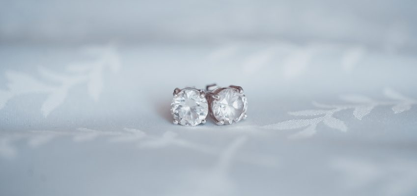 A pair of diamond stud earrings