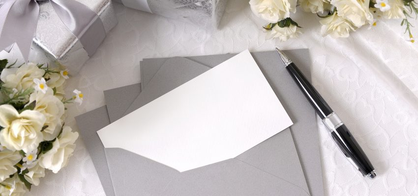 A wedding invitation in an envelope