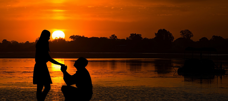 A Proposal on a Beach at Sunset