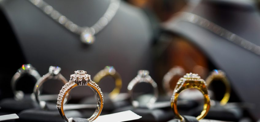 Engagement rings on display in a shop