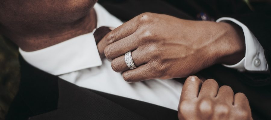 A man wearing an engagement ring