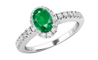 A white gold emerald and diamond gemstone ring