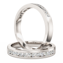 A stunning Round Brilliant Cut diamond set wedding ring in palladium