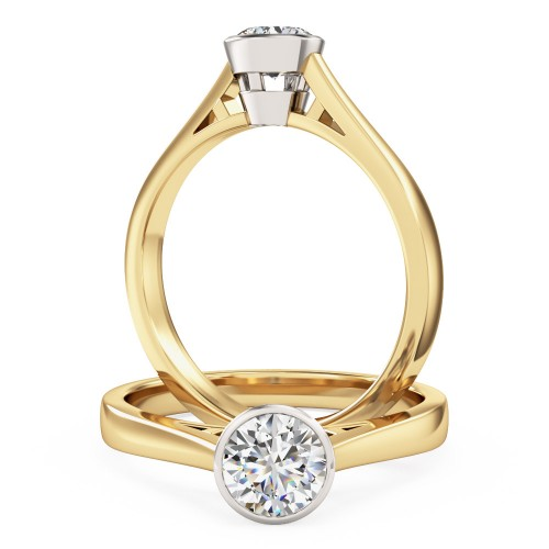 A modern round brilliant cut solitaire diamond ring in 18ct yellow & white gold