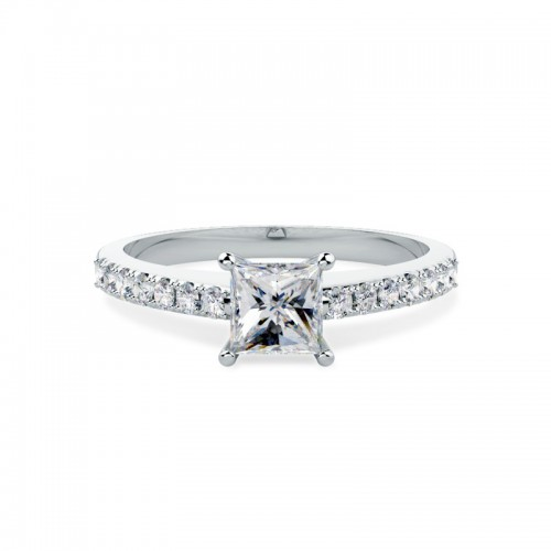 A striking Princess Cut diamond ring with shoulder stones in 18ct white gold