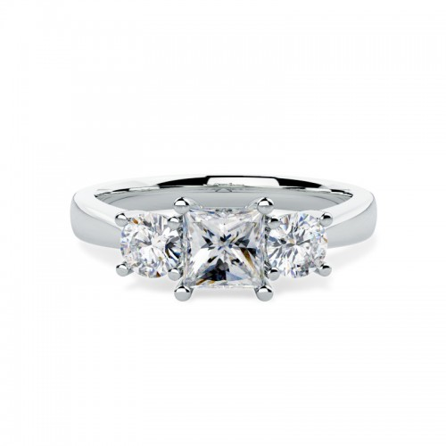 A striking Princess & Round Brilliant Cut three stone diamond ring in platinum