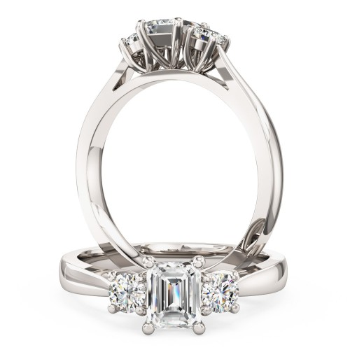 A magnificent Emerald Cut & Round Brilliant Cut three stone diamond ring in platinum