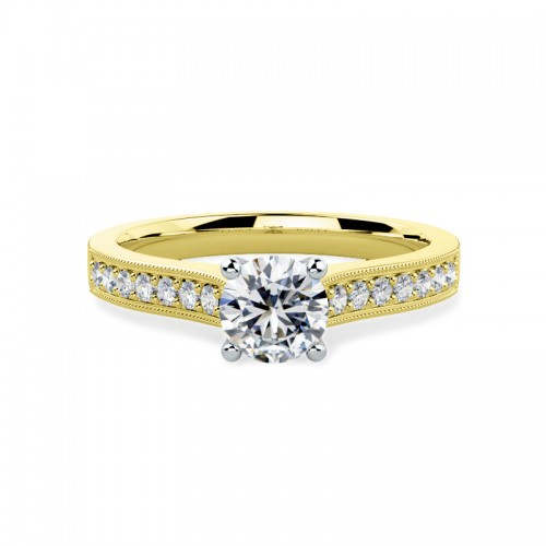 A beautiful Round Brilliant Cut diamond ring with shoulder stones in 18ct yellow & white gold