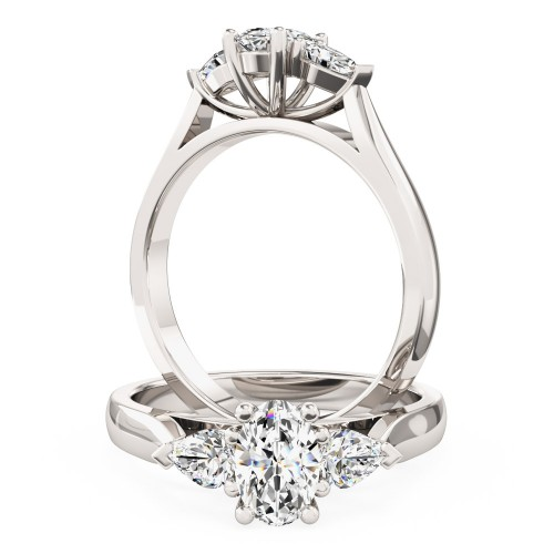 A stylish oval cut and pear shape diamond three stone in platinum