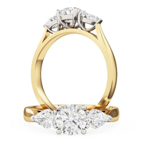 A brilliant cut and pear shaped diamond ring in 18ct yellow & white gold