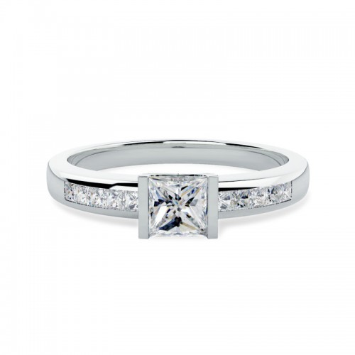 A unique Princess Cut diamond ring with shoulder stones in 18ct white gold (In stock)