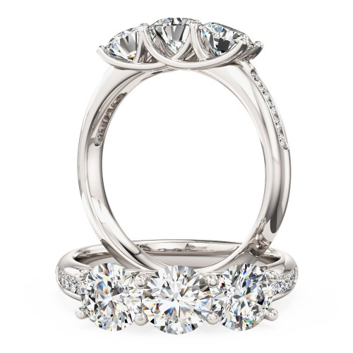 A classic Round Brilliant Cut three stone diamond ring with shoulders in 18ct white gold