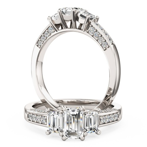 A classic Emerald Cut three stone diamond ring with shoulders in 18ct white gold