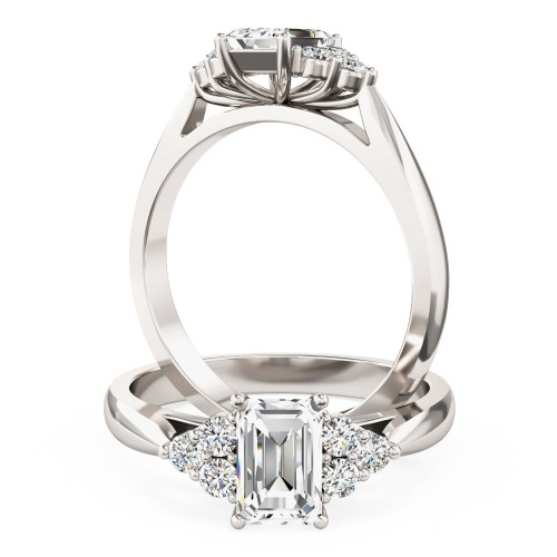 A classic emerald cut diamond ring with small round shoulder stones in 18ct white gold