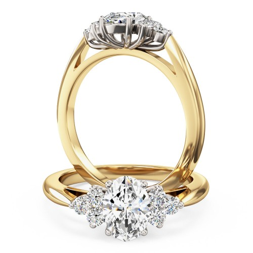A classic Oval Cut diamond ring with shoulder stones in 18ct yellow & white gold