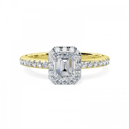 A stunning Emerald cut diamond ring with shoulder stones in 18ct yellow & white gold