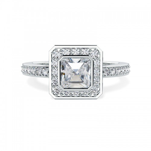 A stunning Asscher Cut diamond ring with shoulder stones in 18ct white gold