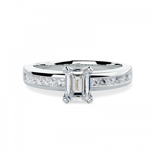 An elegant Emerald Cut diamond ring with shoulder stones in platinum (In stock)