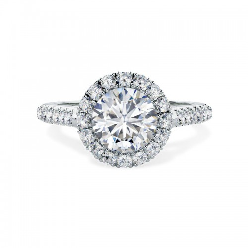 A stunning diamond halo cluster with shoulder stones in platinum