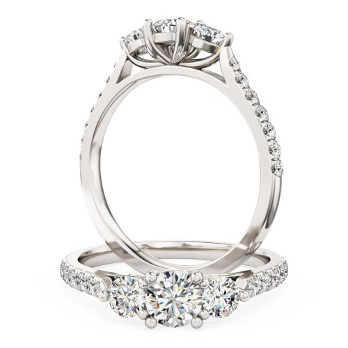 A brilliant cut three stone diamond ring with shoulder stones in 18ct white gold