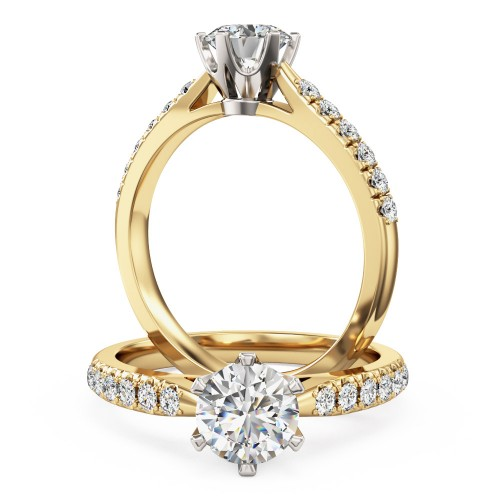 An exquisite solitaire diamond ring with shoulder stones in 18ct yellow & white gold
