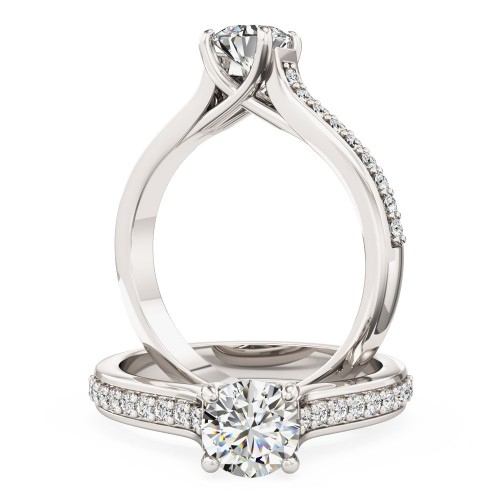 A beautiful Round Brilliant Cut diamond ring with shoulder stones in platinum (In stock)