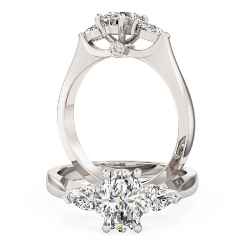 An exquisite oval and pear shape diamond ring in platinum