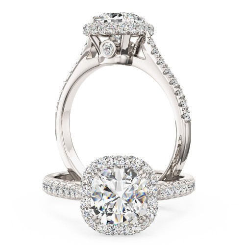 A stunning Cushion Cut halo style diamond ring with shoulder stones in platinum