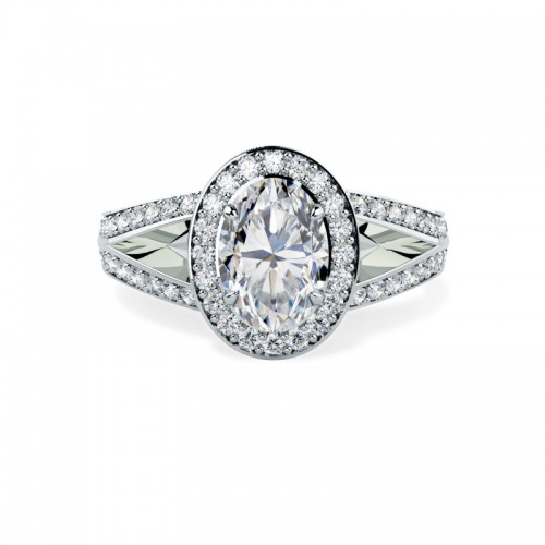 A beautiful oval diamond cluster style ring with shoulder stones in platinum