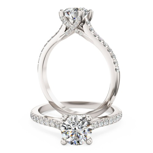 A stunning Round Brilliant Cut diamond ring with shoulder stones in 18ct white gold