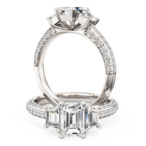 A stunning Emerald Cut diamond ring with shoulder stones in platinum (In stock)