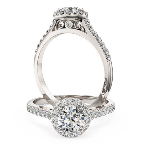A stunning Round brilliant cut diamond Halo ring with shoulder stones in 18ct white gold