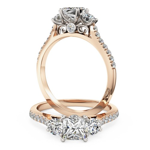 A stunning 3 stone diamond ring with shoulder stones in 18ct rose & white gold