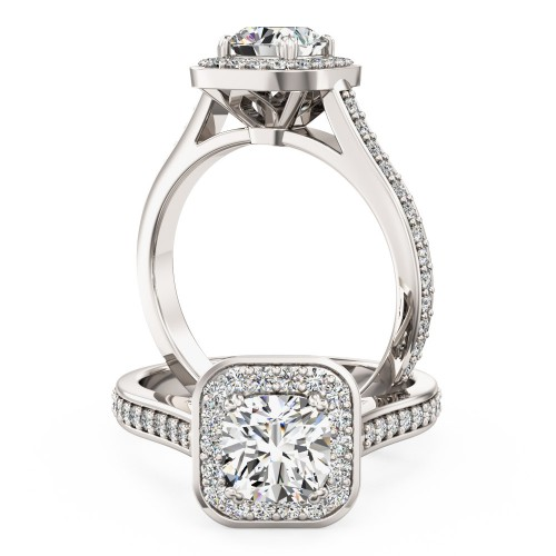 A beautiful Cushion Cut halo style diamond ring with shoulder stones in 18ct white gold