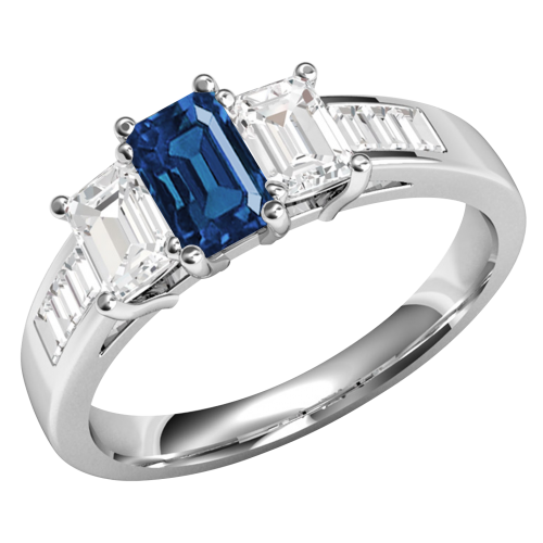 A breathtaking Emerald Cut Sapphire and Diamond three stone ring with shoulders in platinum