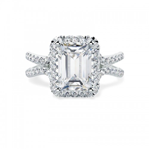A stunning emerald cut diamond halo cluster in 18ct white gold