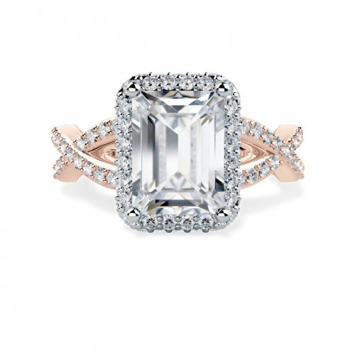 A stunning emerald cut diamond halo cluster in 18ct rose gold & platinum