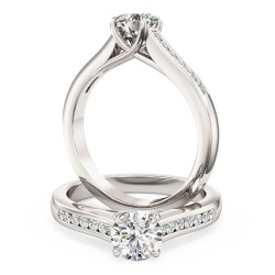 A striking Round Brilliant Cut diamond ring with shoulder stones in platinum