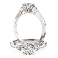 A beautiful Round Brilliant Cut diamond ring with Pear shoulder stones in platinum