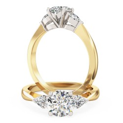 A beautiful round brilliant cut diamond ring with pear shoulder stones in 18ct yellow & white gold