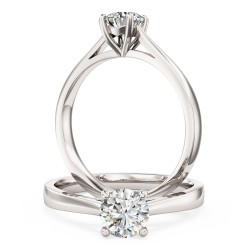 A classic Round Brilliant Cut solitaire diamond ring in palladium