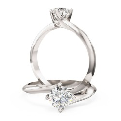 A modern Round Brilliant Cut solitaire twist diamond ring in 18ct white gold