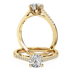 A dazzling round brilliant cut diamond ring with shoulder stones in 18ct yellow gold
