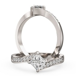 An eye catching Princess Cut diamond ring with shoulder stones in 18ct white gold