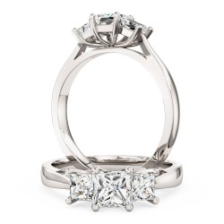 An elegant three stone princess cut diamond ring in 18ct white gold