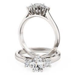 A stunning oval and round brilliant c three stone diamond ring in platinum