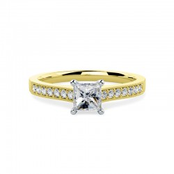 A beautiful Princess Cut diamond ring with shoulder stones in 18ct yellow & white gold