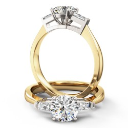 A stylish Round Brilliant Cut diamond ring with shoulder stones in 18ct yellow & white gold